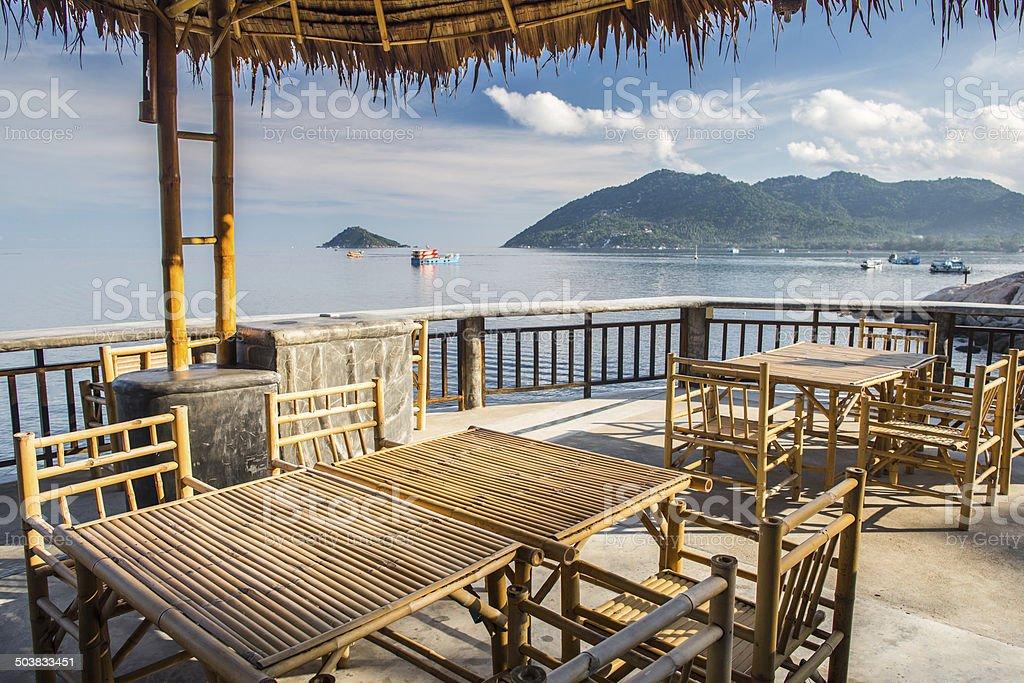 Wooden table in sea seaside restuarant stock photo