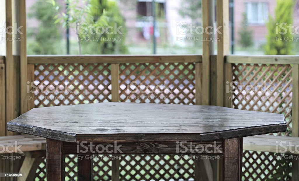 Wooden Table In The Bower stock photo
