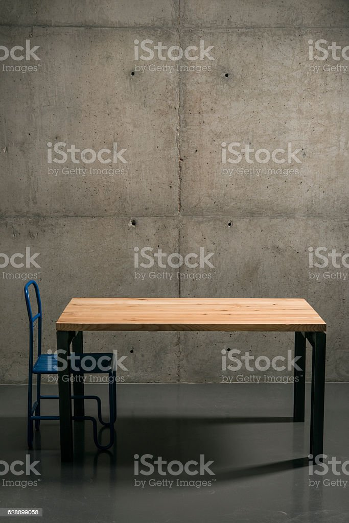 wooden table in the room, loft style gray concrete stock photo