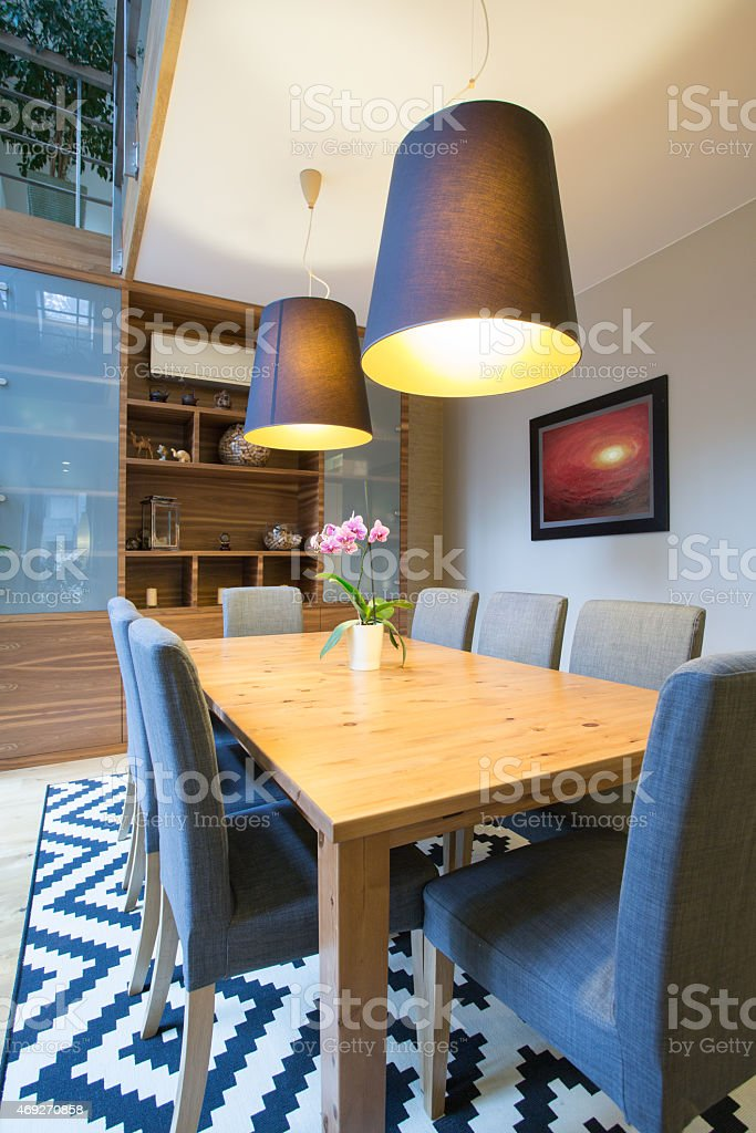 Wooden table inside modern interior stock photo
