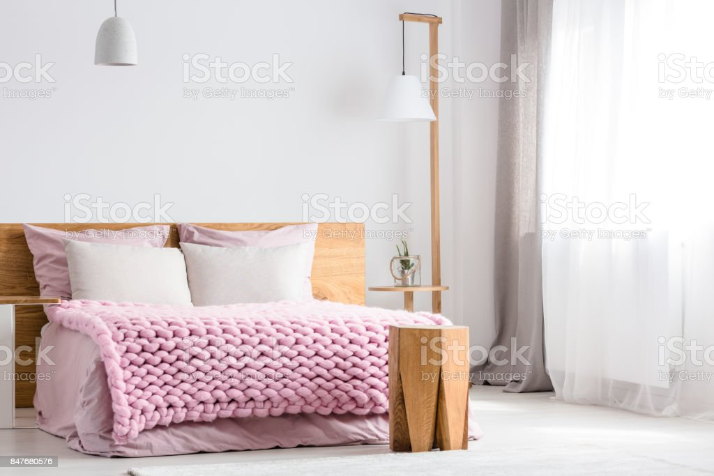 Wooden table next to bed stock photo