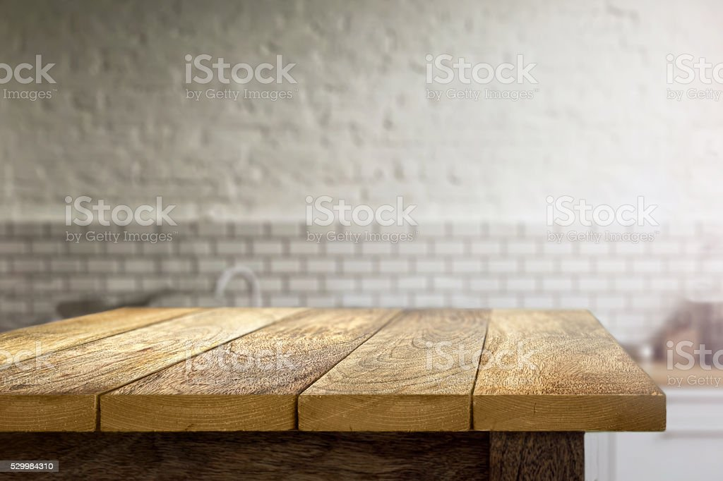 Kitchen Table Top Background wooden table on blurred background of kitchen stock photo