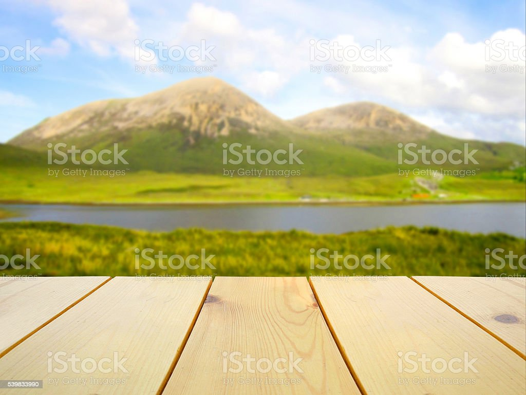 Wooden table on blurred Isle of Skye, Scotland stock photo