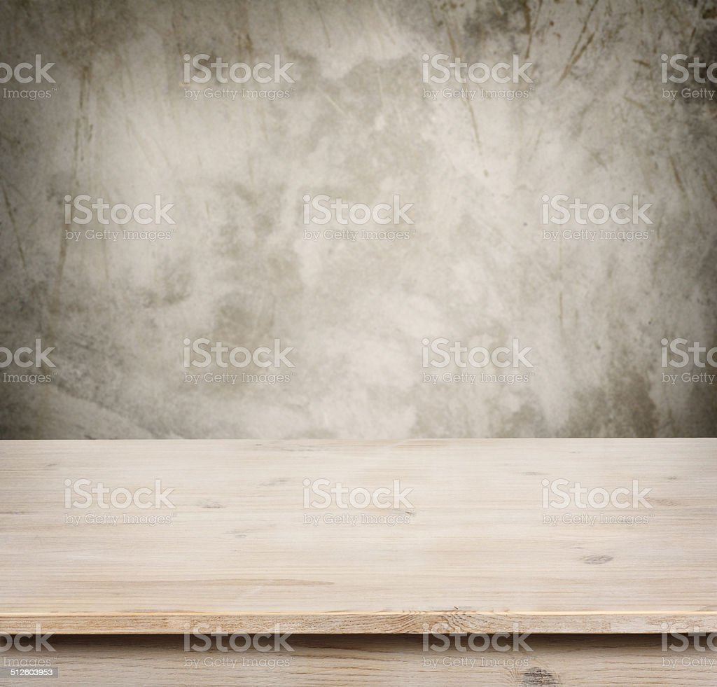 Wooden table on defocuced vintage wall background stock photo