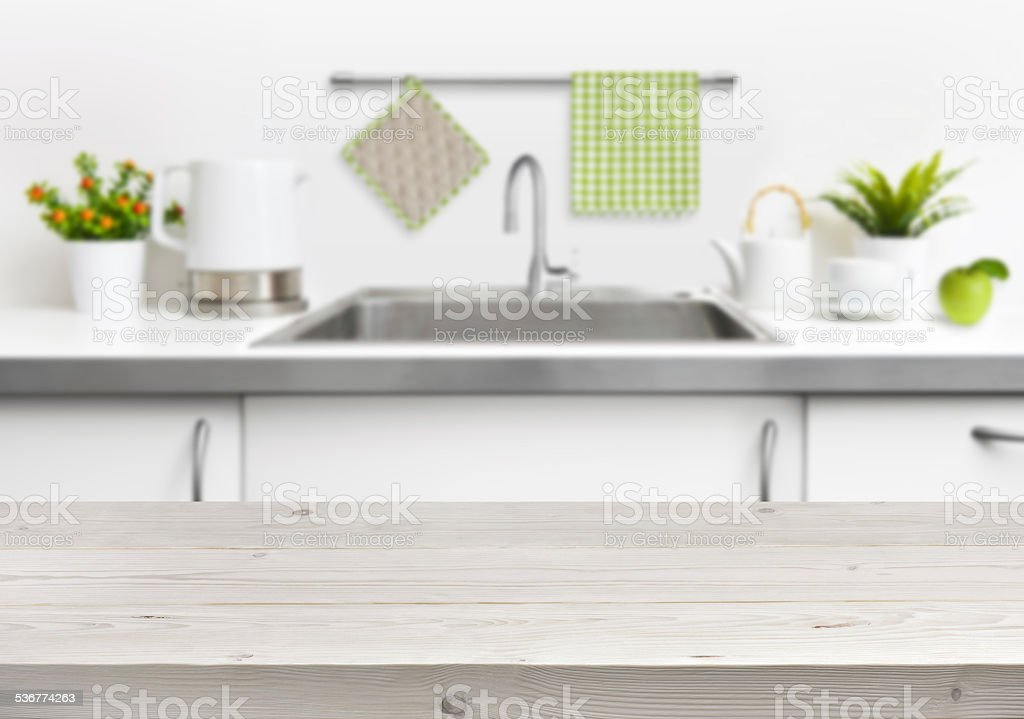 Wooden table on kitchen sink interior background stock photo