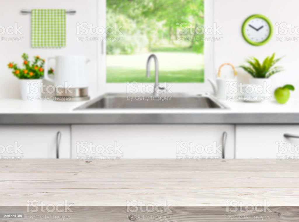 Wooden table on kitchen sink window background stock photo
