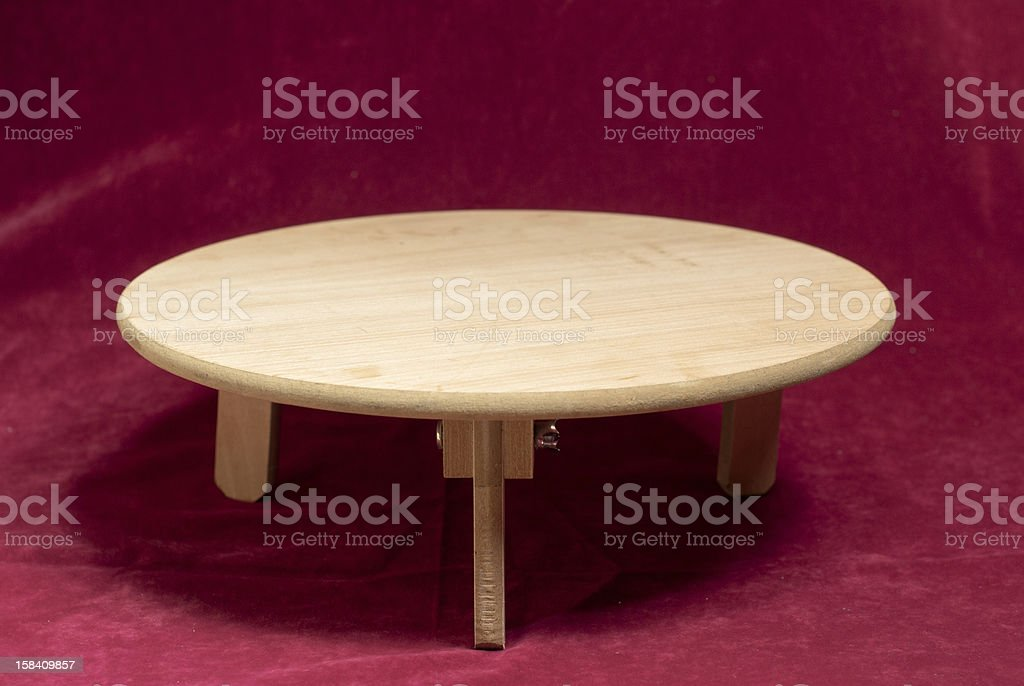 Wooden Table on Red Background royalty-free stock photo