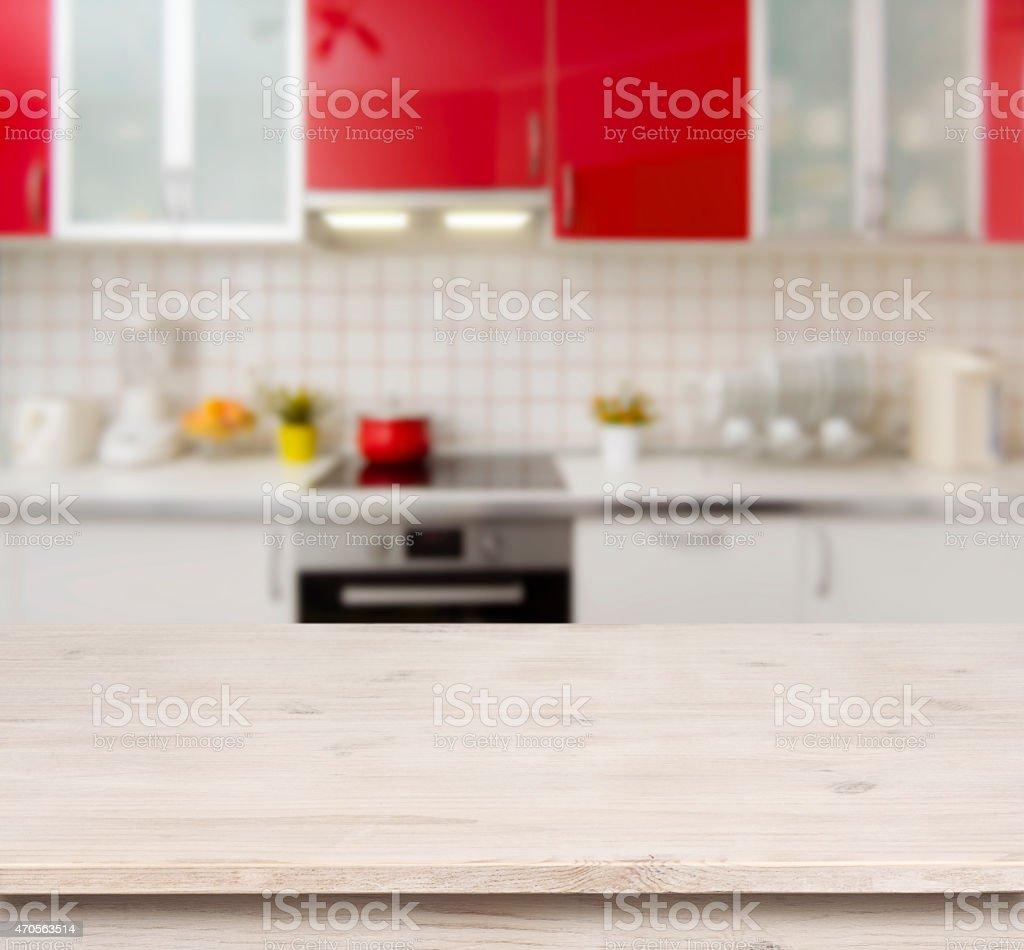 Wooden table on red modern kitchen bench interior background stock photo