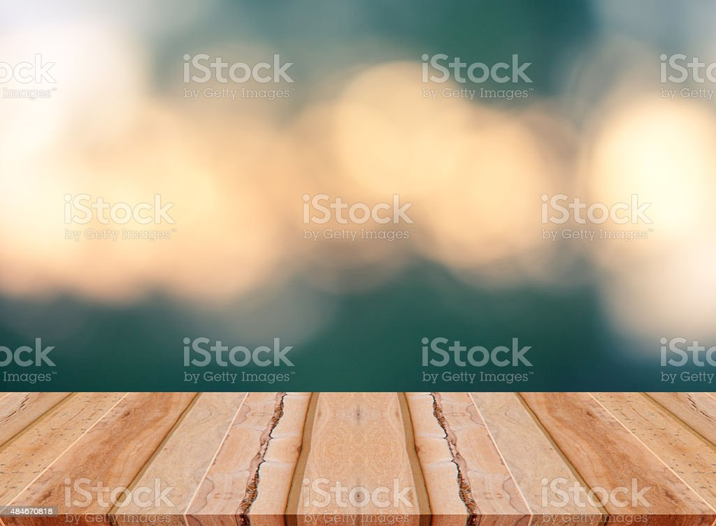 Wooden table on vintage bokeh background stock photo