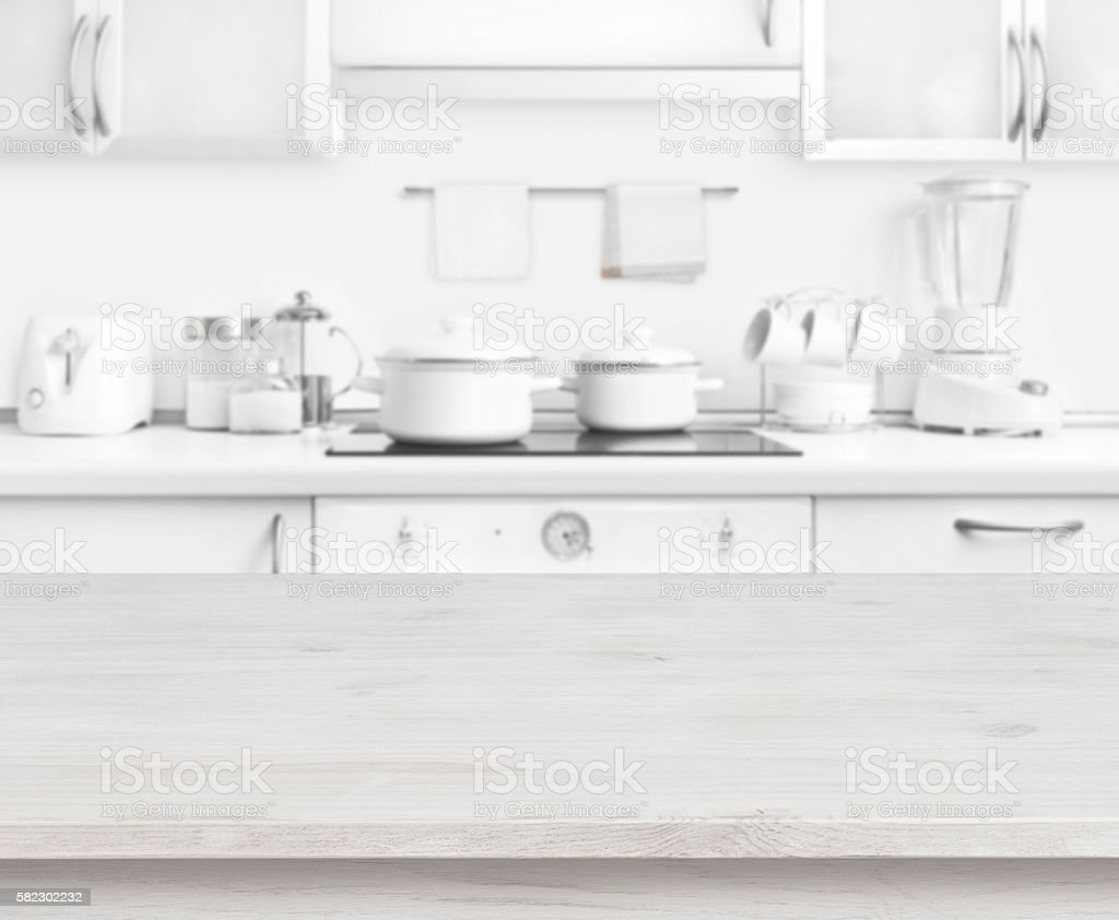 Wooden table on white modern kitchen interior background, pastel colors stock photo