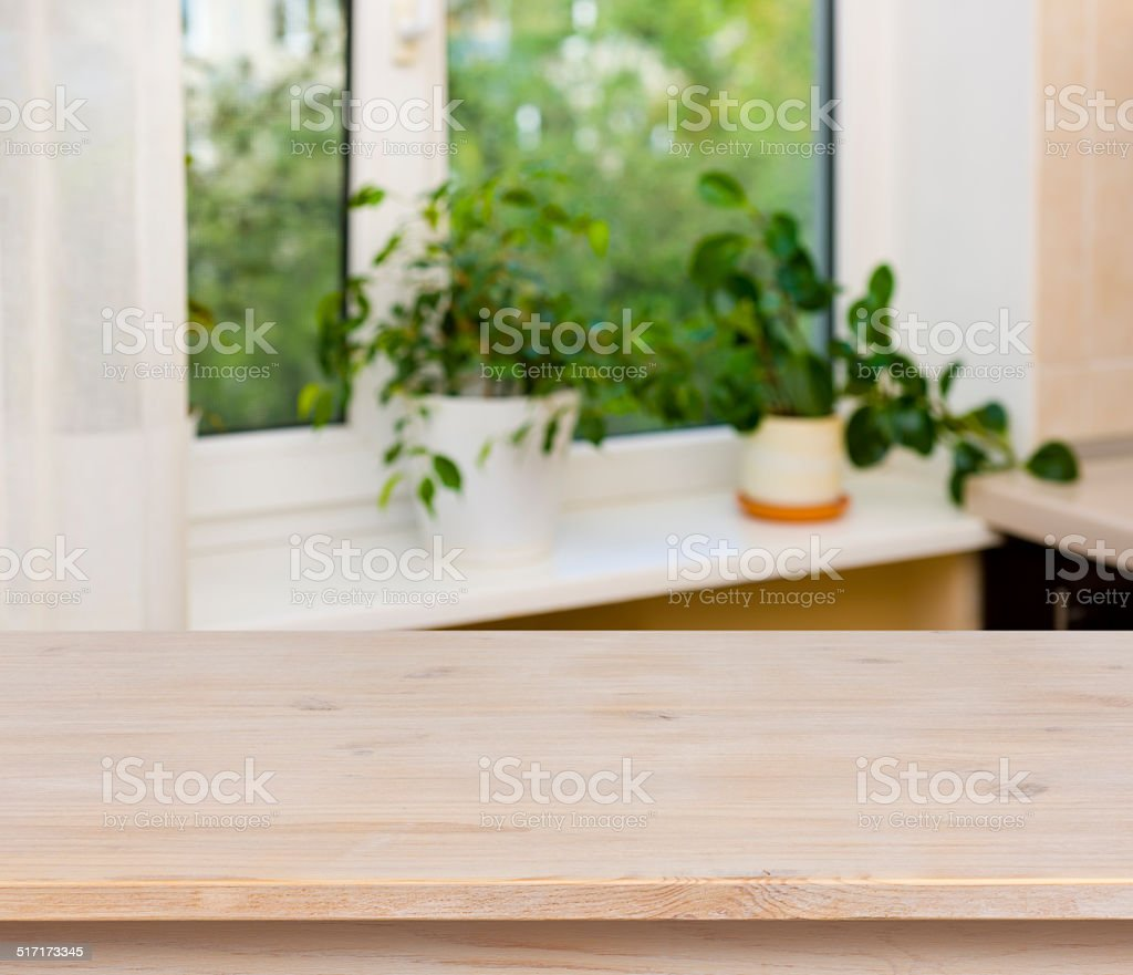 Wooden table on window background stock photo