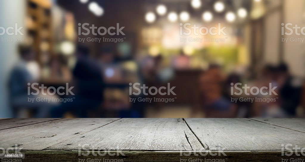 Wooden table platform and bokeh at night for present product stock photo
