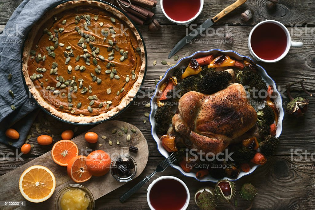 Wooden table served for Thanksgiving dinner top view stock photo