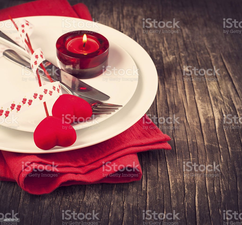 A wooden table set for Valentine's Day stock photo