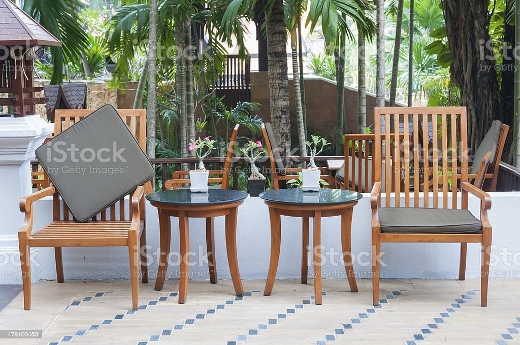 wooden table set in garden setting royalty-free stock photo