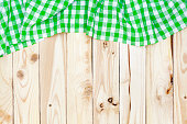 Wooden table, top view, green checkered tablecloth