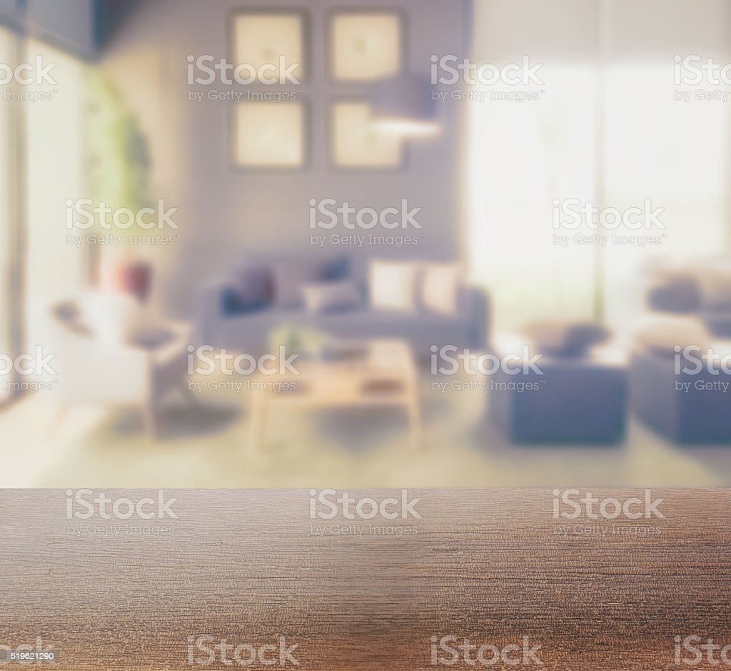 Empty wood table and blurred living room background stock photo - Wooden Table Top With Blur Background Of Modern Living Room Stock Photo