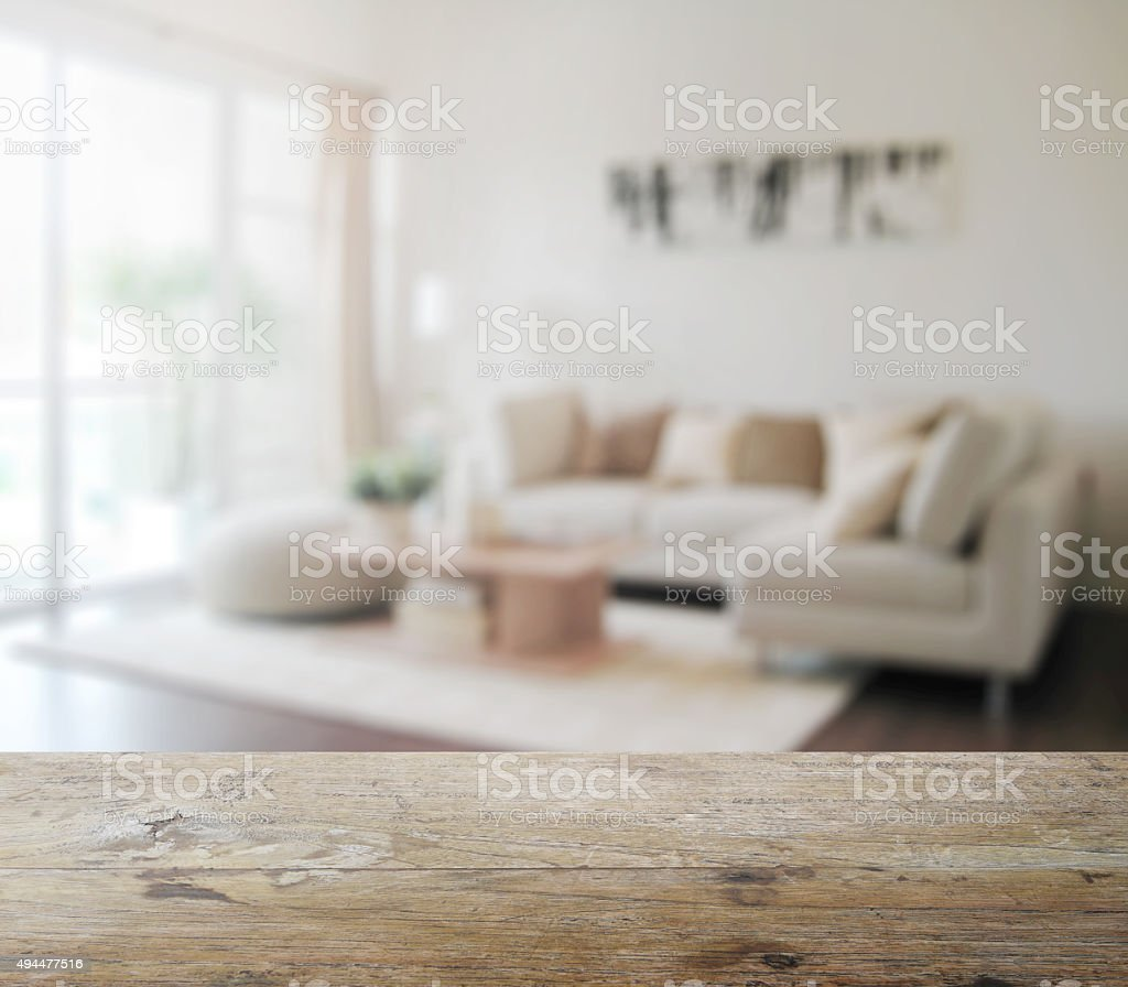 Empty wood table and blurred living room background stock photo -  Wooden Table Top With Blur Of Modern Living Room Interior Stock Photo