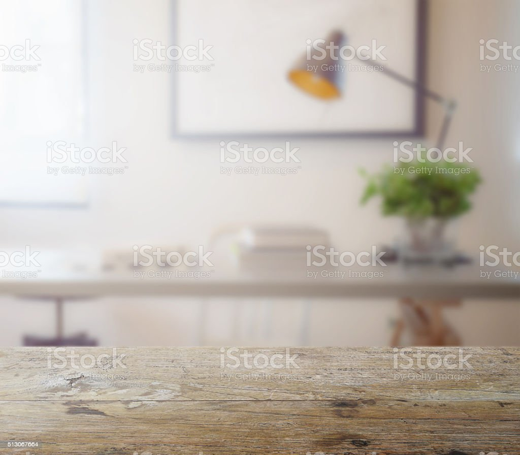 wooden table top with blur of modern working table stock photo