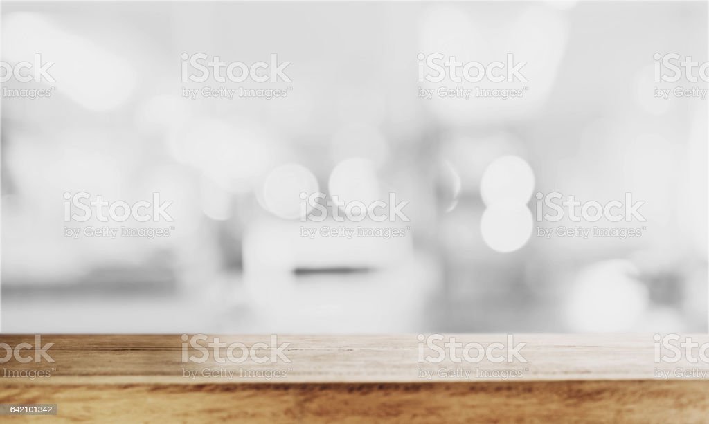 Wooden table top with Bokeh defocus backgrounds stock photo