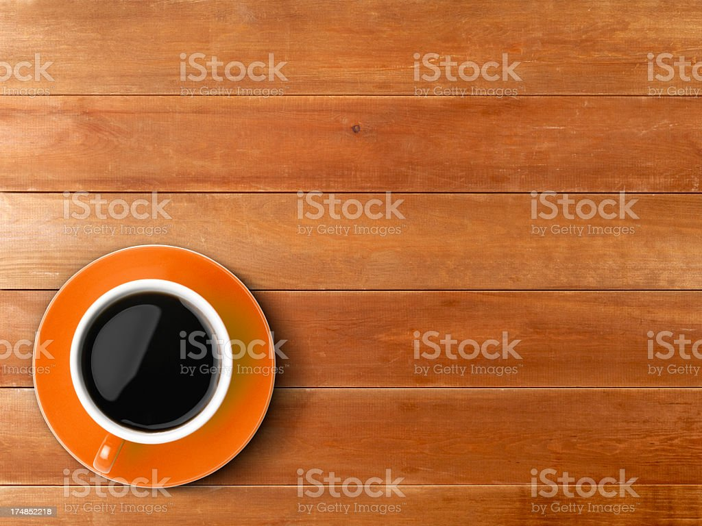 A wooden table with a cup of coffee royalty-free stock photo