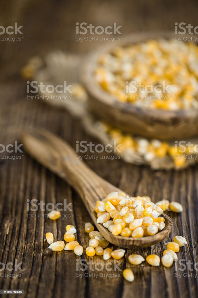 Wooden table with a portion of Corn stock photo