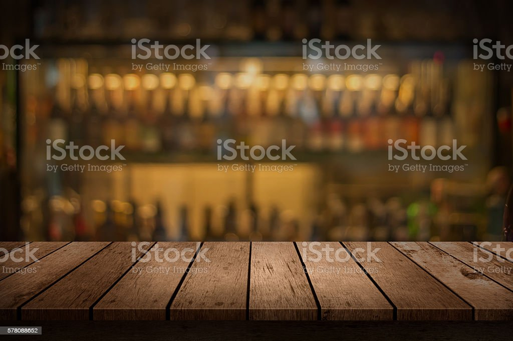 ... Wooden Table With A View Of Blurred Beverages Bar Backdrop Stock Photo  ...