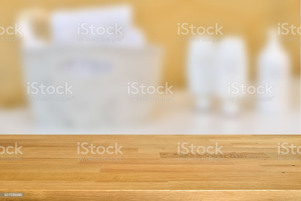 Wooden table with blurred beauty salon treatments background stock photo