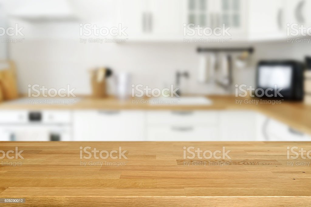Kitchen Table Top Background wooden table with blurred kitchen background stock photo 525230012