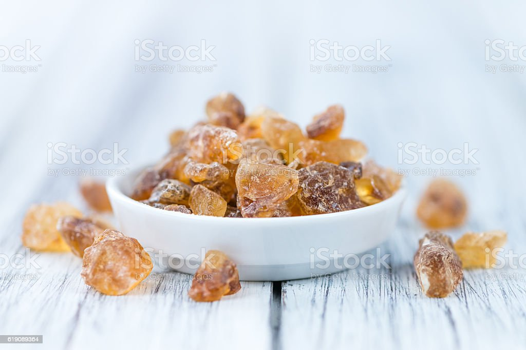 Wooden table with brown Rock Candy stock photo