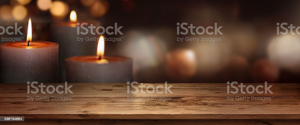 Wooden table with candles background stock photo