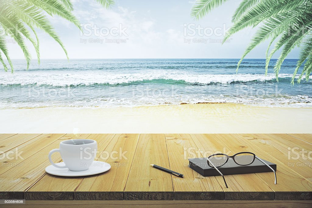 Wooden table with cup of coffee, eyeglasses and diary stock photo