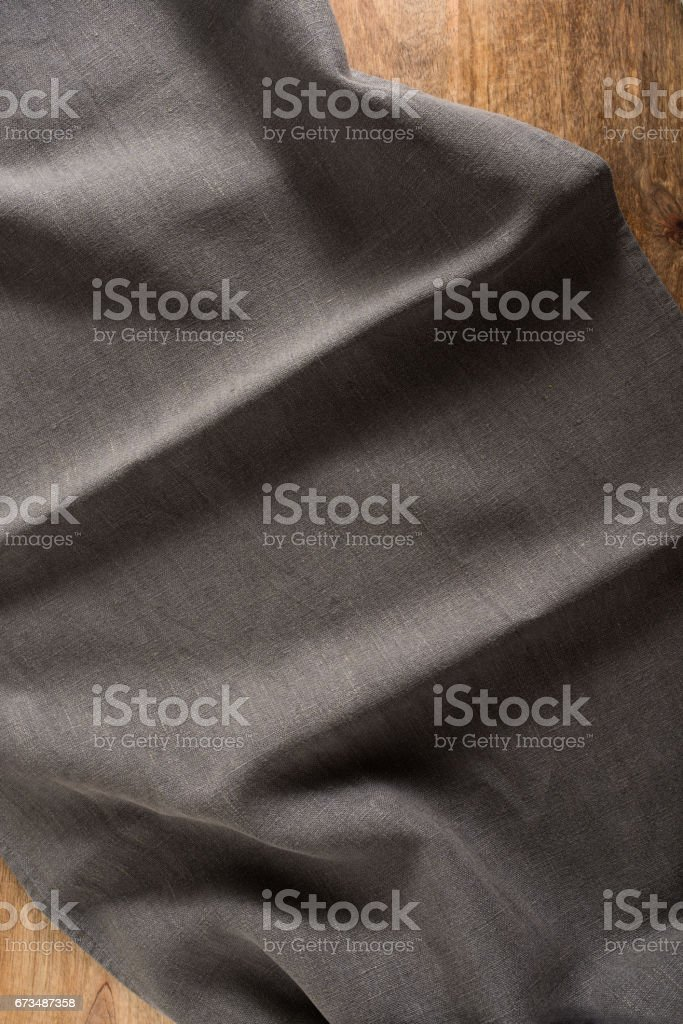 Wooden table with dark tablecloth stock photo