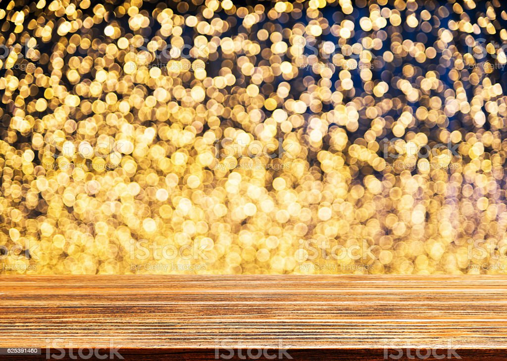 Wooden table with defocused lights background stock photo