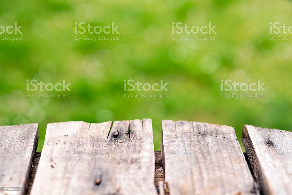 wooden table with green blurred background stock photo