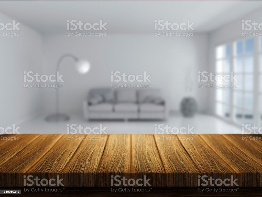 Wooden table with room interior in background stock photo