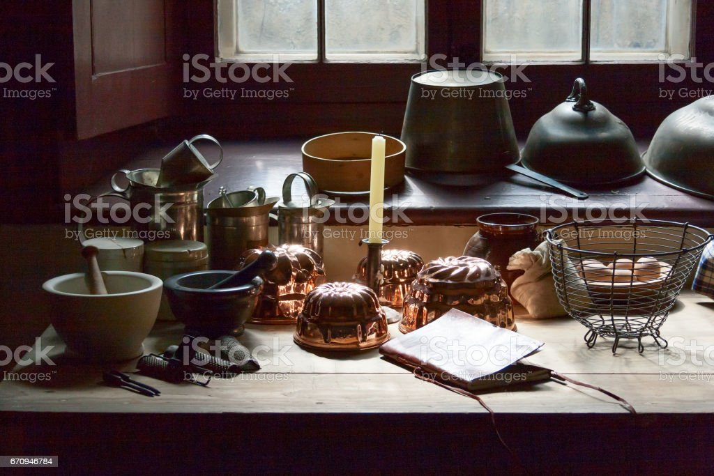 Wooden table with rustic kitchen utensils stock photo
