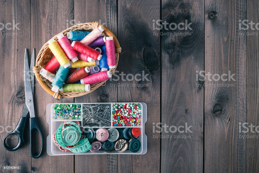 Wooden table with sewing utensils stock photo