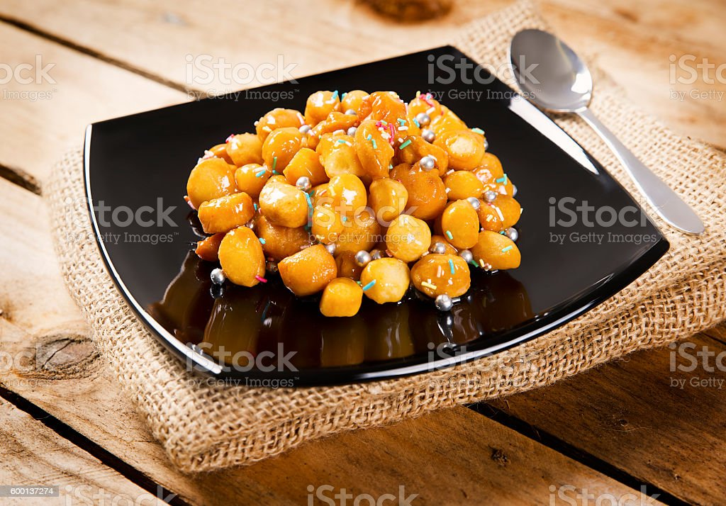 wooden table with struffoli and herbal tea stock photo