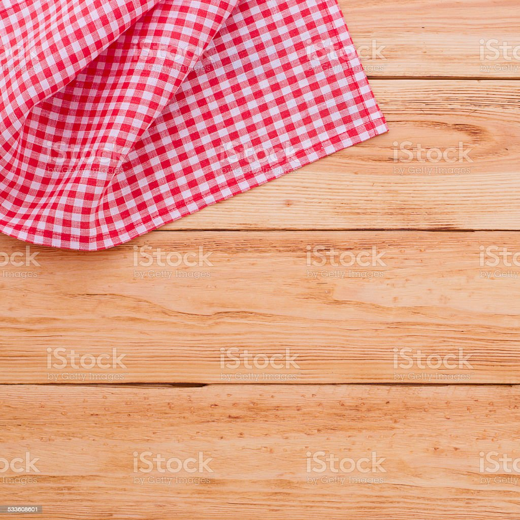 Wooden table with tablecloth tartan top view stock photo