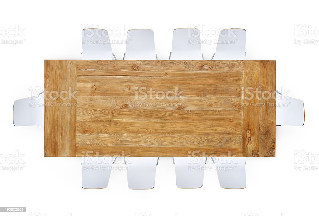 Wooden Table with Ten Chairs Around stock photo