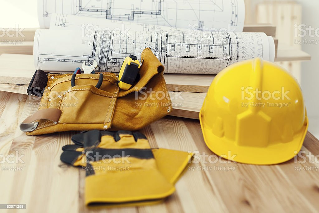 Wooden table with work tools stock photo