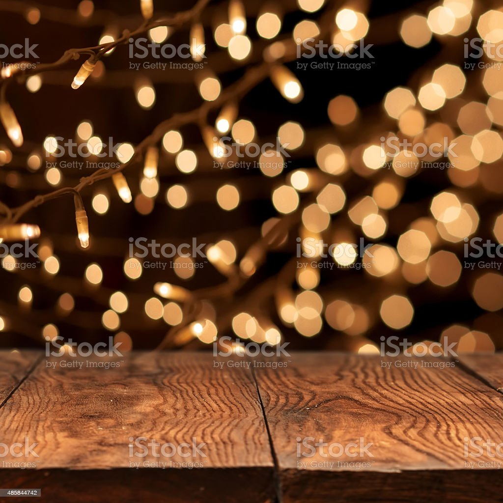 wooden table with yellow bokeh on background stock photo