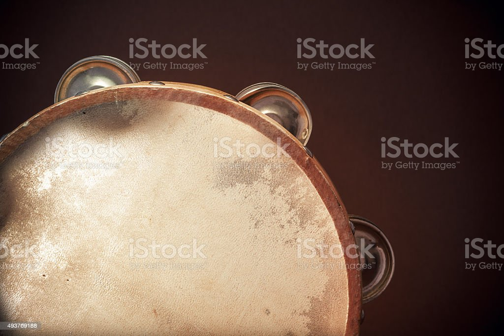 Wooden Tambourine on Brown Background stock photo