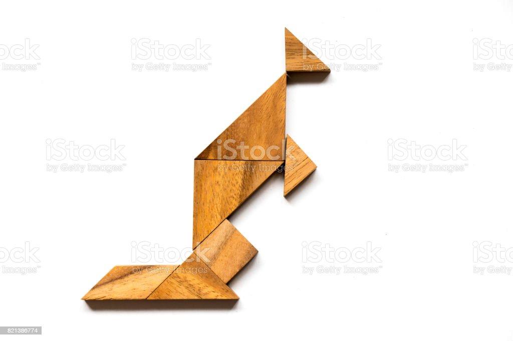 Wooden tangram in kangaroo shape on white background stock photo