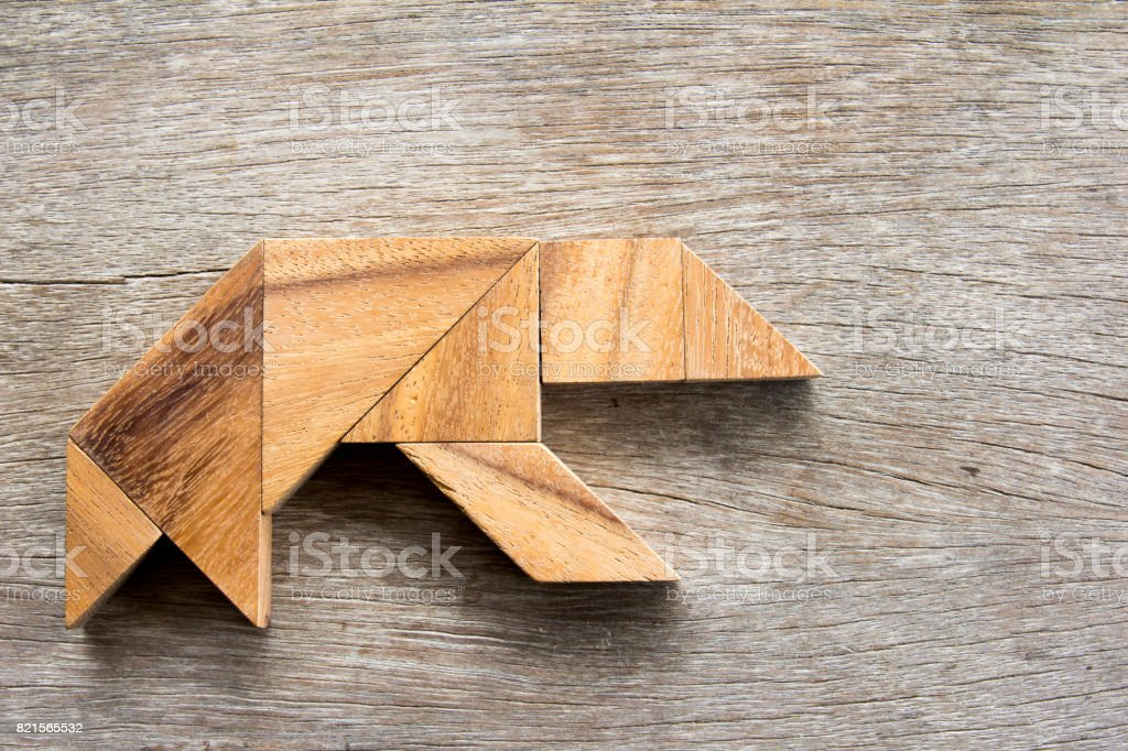 Wooden tangram puzzle in bear shape background stock photo
