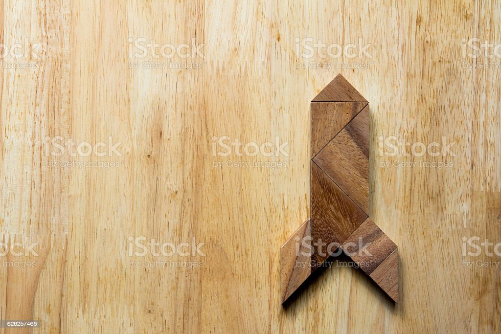 Wooden tangram puzzle in rocket shape stock photo