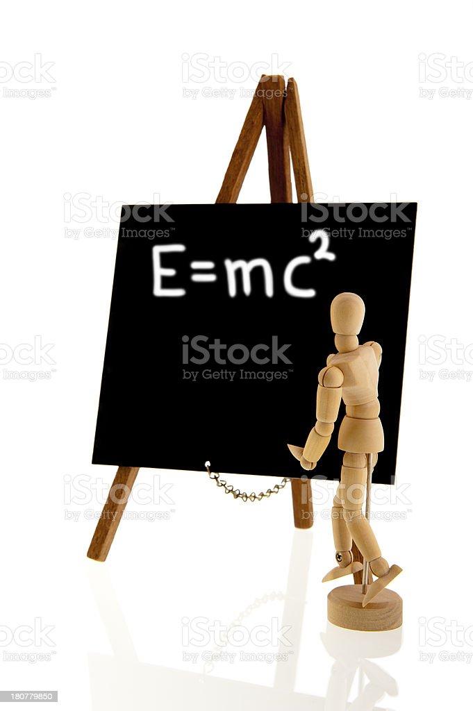 Wooden teacher in front of blackboard royalty-free stock photo
