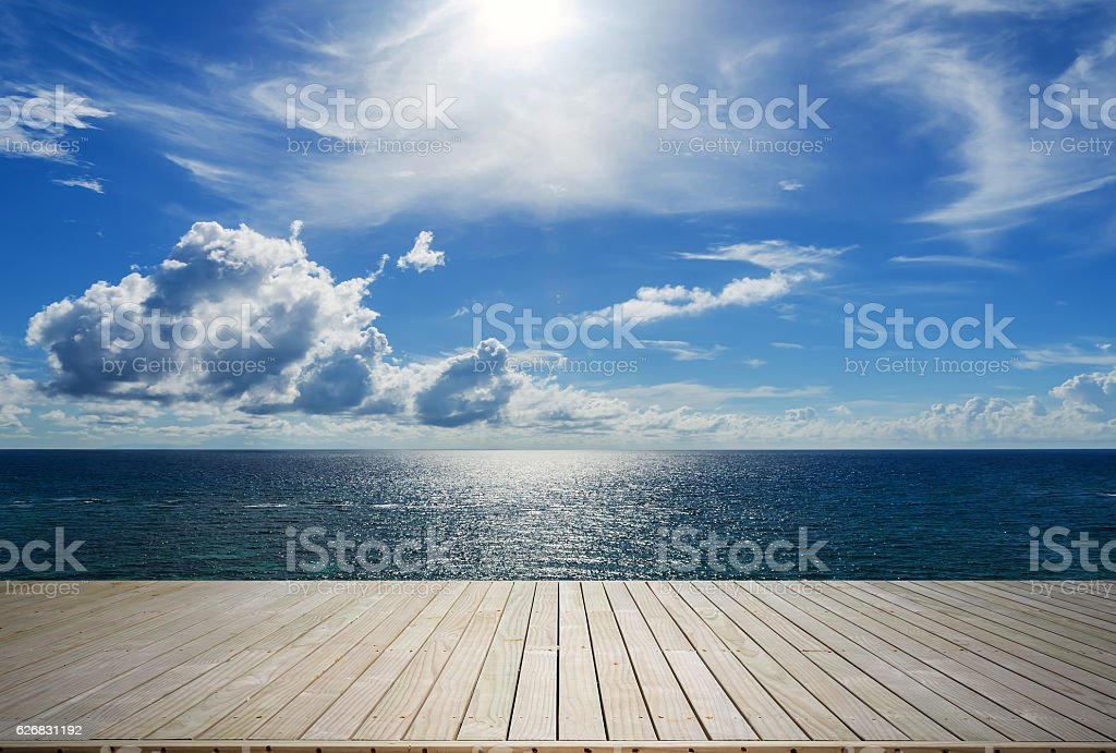 Wooden terrace beside tropical sea stock photo