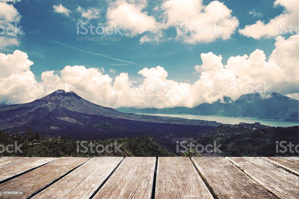 Wooden terrace landscape of mountain and sky background, vintage tone stock photo